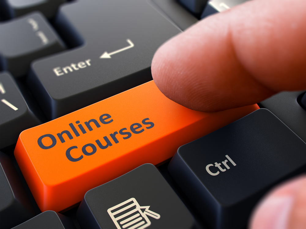 Online Courses orange key on computer keyboard